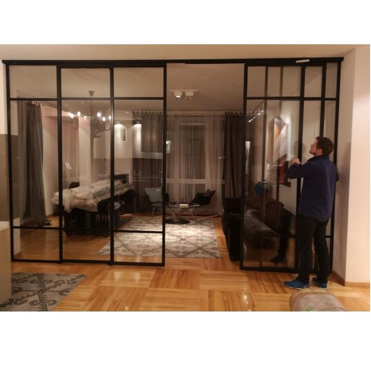 Drzwi LOFT industrialne przesuwne czteroskrzydłowe metalowe szklane Mag Haus